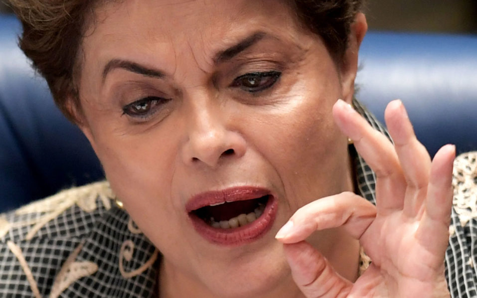 Suspended Brazilian President Dilma Rousseff answers to questions during the impeachment trial, at the National Congress in Brasilia, on August 29, 2016. Rousseff who testified for the first time at her trial, urged the Senate to vote against impeaching her, denying charges that she fiddled government accounts.  / AFP PHOTO / EVARISTO SA