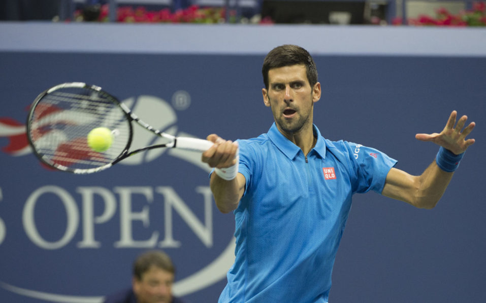 Novak Djokovic of Serbia returns against Jerzy Janowicz of Poland during their 2016 US Open 2016 Men's Singles match at the USTA Billie Jean King National Tennis Center on August 29, 2016 in New York.  / AFP PHOTO / Don EMMERT
