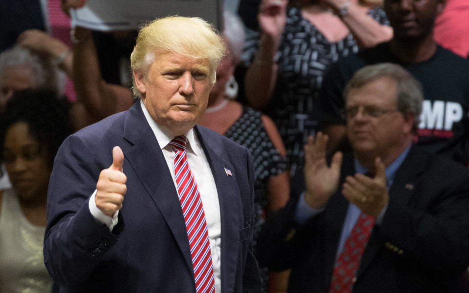 "(FILES) This file photo taken on August 22, 2016 shows Republican presidential nominee Donald Trump gestures following his speach during a campaign rally in Austin, Texas. Donald Trump is committed to a ""fair and humane"" approach to securing America's borders, but details of his evolving immigration policy will be revealed at a later time, his presidential campaign team said on  August 28, 2016. The Republican presidential candidate's hardline stance on repatriating the 11 million undocumented immigrants in the United States has been a central tenet of Trump's White House campaign -- and a hugely popular selling point to his most ardent supporters. To keep illegal migrants out, Trump has promised to build a wall on America's southern border -- to be paid for, he has declared at rally after campaign rally, by Mexico.  / AFP PHOTO / SUZANNE CORDEIRO"