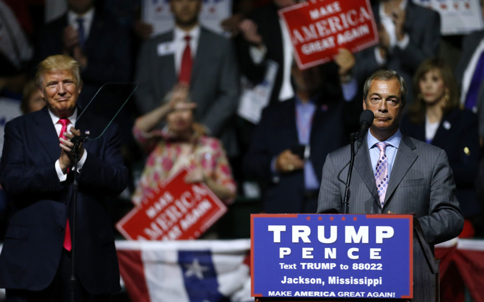 JACKSON, MS - AUGUST 24: Republican Presidential nominee Donald Trump, left, listens to United Kingdom Independence Party leader Nigel Farage speak during a campaign rally at the Mississippi Coliseum on August 24, 2016 in Jackson, Mississippi. Thousands attended to listen to Trump's address in the traditionally conservative state of Mississippi.   Jonathan Bachman/Getty Images/AFP
