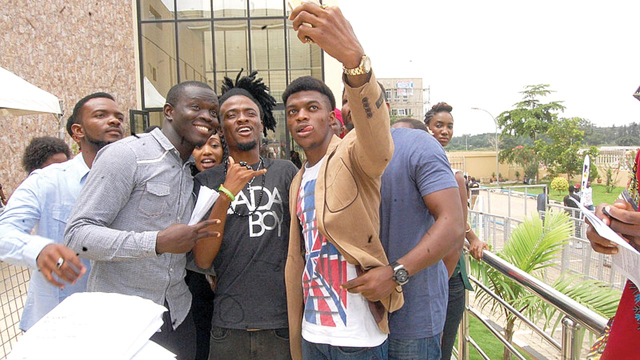 Show host Ehiz (middle) with contestants in Abuja.