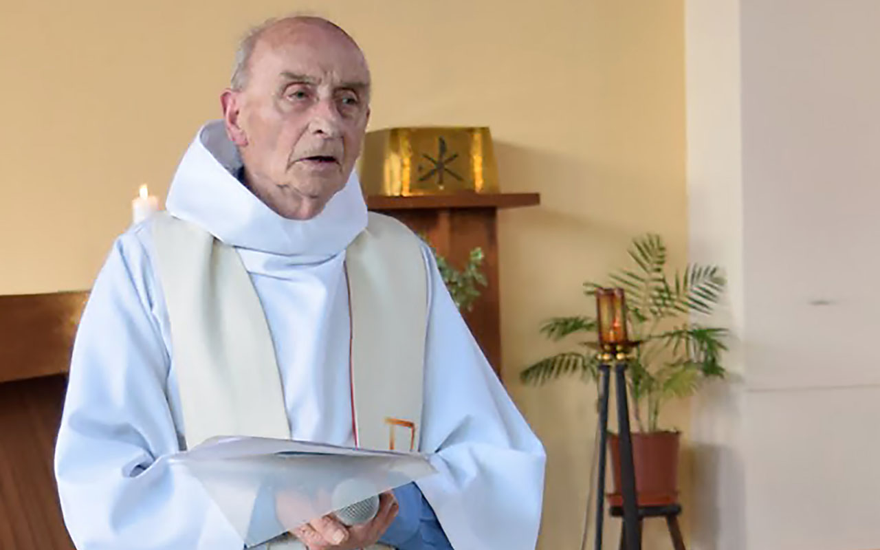 (FILES) This file picture obtained on the website of the Saint-Etienne-du-Rouvray parish on July 26, 2016 shows late priest Jacques Hamel celebrating a mass on June 11, 2016 in the church of Saint-Etienne-du-Rouvray, Normandy. French priest Father Jacques Hamel, who was murdered in an attack on his Catholic church in a Normandy town.