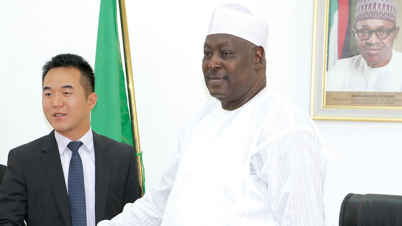 Managing Director, Huawei Nigeria, Teng Li (left) and the Secretary to the Government of the Federation, Babachir David Lawal, at the signing of a Memoradum of Understanding between the government and Huawei on the firm's Corporate Social Responsibility project 'Seeds for the Future' program, targeted at deepening ICT in Nigeria, in Abuja.