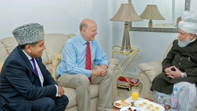 Hazrat Mirza Masroor Ahmad (right); Chris Grayling; and Tariq Ahmad… during the visit