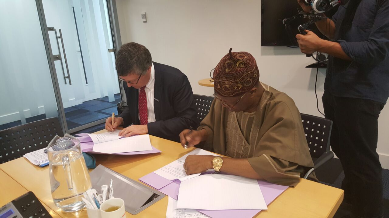R-L: Minister of Information and Culture Lai Mohammed and Sir Ciaran Devane, Chief Executive of the British Council signing an MoU on Cultural Cooperation in Edinburgh, Scotland, on Wednesday.