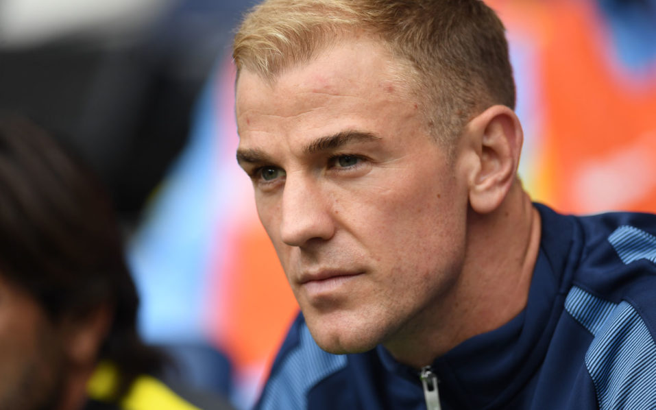 Manchester City's English goalkeeper Joe Hart sits on the substitutes bench for the English Premier League football match between Manchester City and Sunderland at the Etihad Stadium in Manchester, north west England, on August 13, 2016. Manchester City manager Pep Guardiola dropped goalkeeper Joe Hart in favour of Willy Caballero for his opening Premier League game against Sunderland on August 13. / AFP PHOTO / PAUL ELLIS /