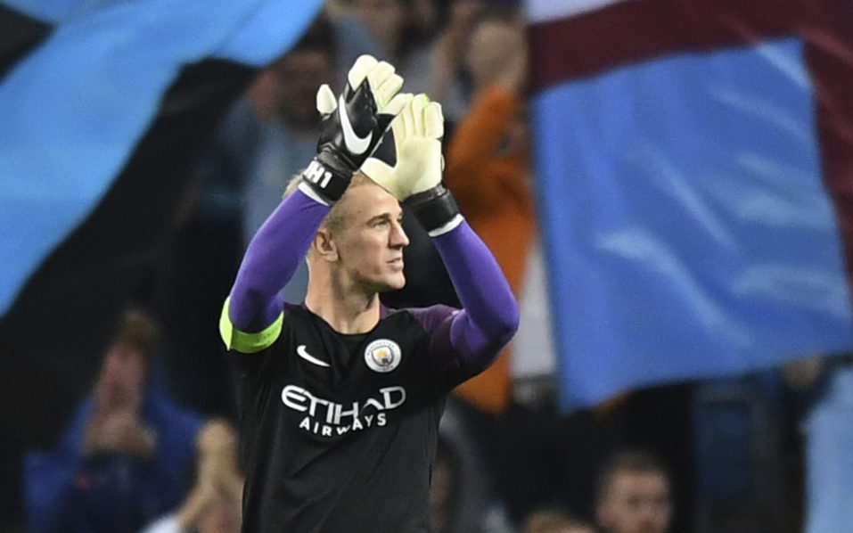 Manchester City's English goalkeeper Joe Hart gestures to the crowd after the UEFA Champions League second leg play-off football match between Manchester City and Steaua Bucharest at the Etihad Stadium in Manchester, north west England on August 24, 2016. / AFP PHOTO / Anthony Devlin