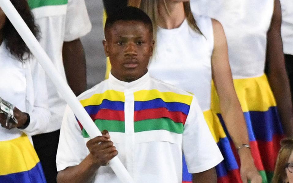 Namibia's flagbearer Jonas Junias Jonas / AFP PHOTO / PEDRO UGARTE