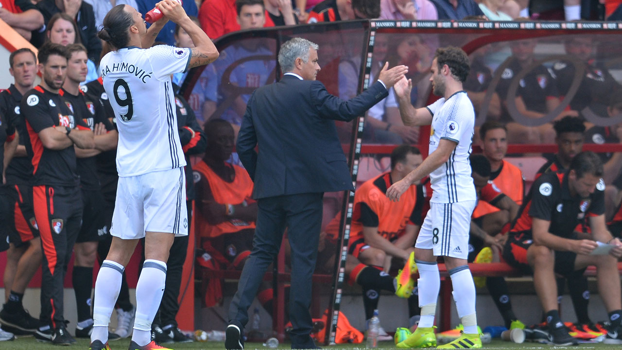 Manchester United's Spanish midfielder Juan Mata (R) touches hands with Manchester United's Portuguese manager Jose Mourinho (C) as he is substituted during the English Premier League football match between Bournemouth and Manchester United at the Vitality Stadium in Bournemouth, southern England on August 14, 2016. GLYN KIRK / AFP
