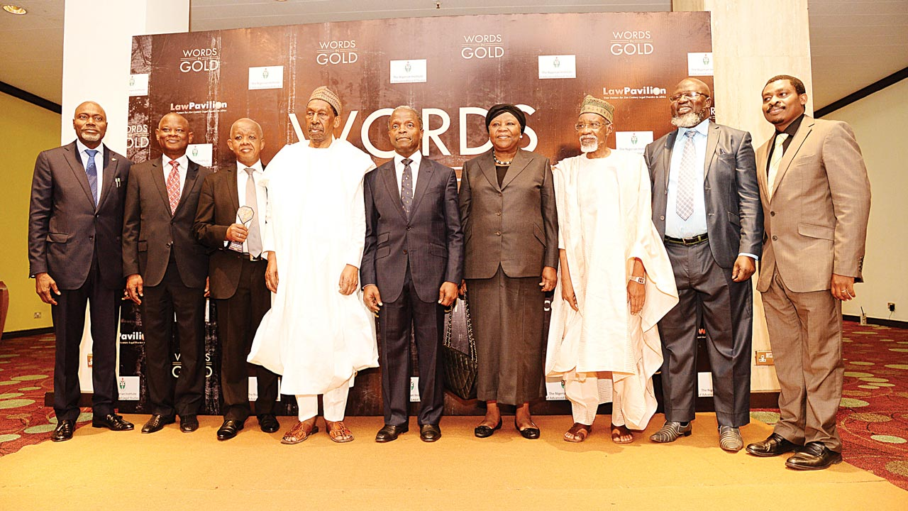 Mallam Yusuf Ali, SAN (left); Mr. Kola Awodein, SAN; Justice Adeniyi Ademola of the Federal High Court, representing his grand father, Justice Adetokunbo Ademola, the first indigenous Chief Justice of Nigeria; Former Chief Justice of Nigeria, Justice Mohammed Lawal Uwais, GCON; Vice President of Nigeria, Prof. Yemi Osinbajo, SAN; Former Chief Justices of Nigeria, Justice, Maryam Aloma Mukhtar, GCON and Justice Dahiru Musdapha, GCON; Minister of Communications, Mr. Adebayo Shittu and Mr. Ope Olugasa, Managing Director of LawPavilion at the just concluded Words-in-Gold Judicial Awards ceremony and unveiling of LawPavilion Prime with Case Analytics at Sheraton Hotel, Abuja.
