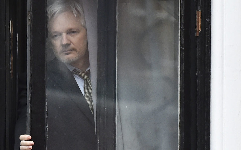 """This file photo taken on February 5, 2016 shows WikiLeaks founder Julian Assange as he comes out on the balcony of the Ecuadorian embassy to address the media in central London. WikiLeaks founder Julian Assange has warned that his anti-secrecy campaign will release new documents concerning Democratic presidential candidate Hillary Clinton, which could be """"significant"""" for the election.Speaking to Fox News on August 24, 2016, Assange, who has been sheltering in the Ecuadorian embassy in London since 2012 while fighting extradition, said WikiLeaks was combing through thousands of pages of material.  / AFP PHOTO / BEN STANSALL"""