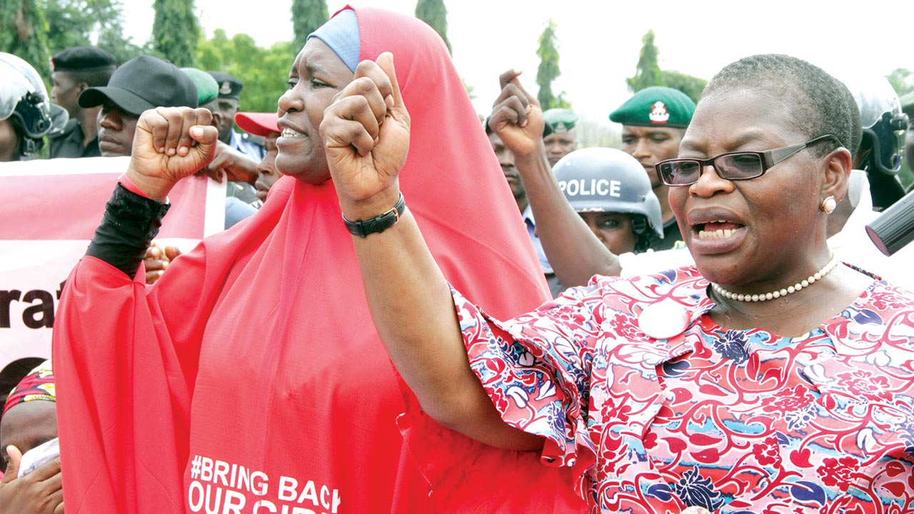Leader of the Bring Back Our Girls (BBOG) group, Oby Ezekwesili (right) and others at the main entrance to the Presidential Villa, Abuja. 			  		         PHOTO:  PHILIP OJISUA