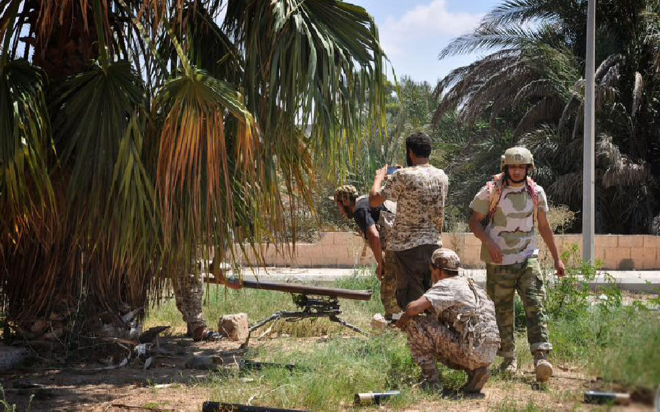 A handout picture taken on July 31, 2016 and uploaded on August 1, 2016 on the official Facebook page of the media centre of the forces of Libya's Government of National Accord's (GNA) military operation against the Islamic State group in Sirte, shows members of forces loyal to Libya's unity government taking part in the military operations against the Islamic State group in Dollar neighborhood in the center of Sirte, situated 450 kilometres (280 miles) east of Tripoli. US warplanes on August 1, 2016 carried out air strikes on positions of the Islamic State group in the Libyan city of Sirte for the first time, the country's unity government head announced. / AFP PHOTO / Media center of the GNA forces military operation against IS in Sirte / HO /