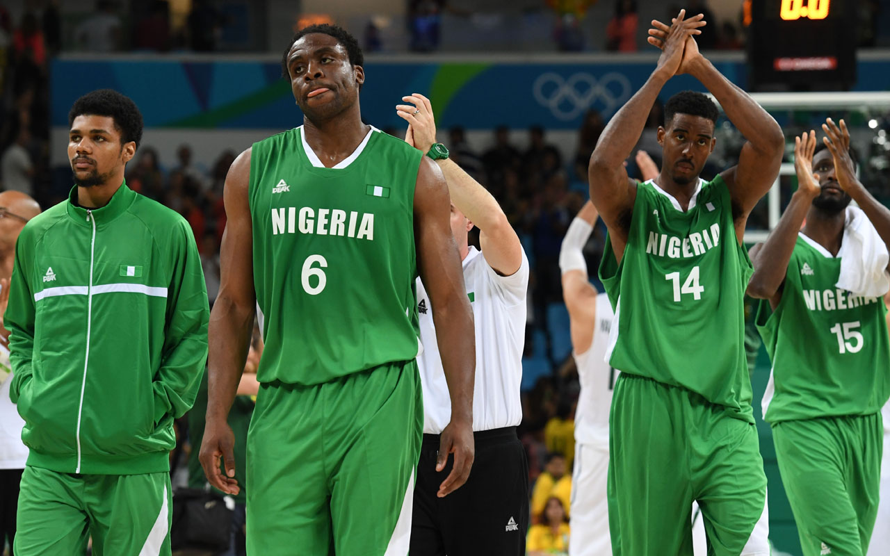 Nigeria players leave the court after losing a Men's round Group B basketball match between Lithuania and Nigeria at the Carioca Arena 1 in Rio de Janeiro on August 9, 2016 during the Rio 2016 Olympic Games. / AFP PHOTO / Mark RALSTON