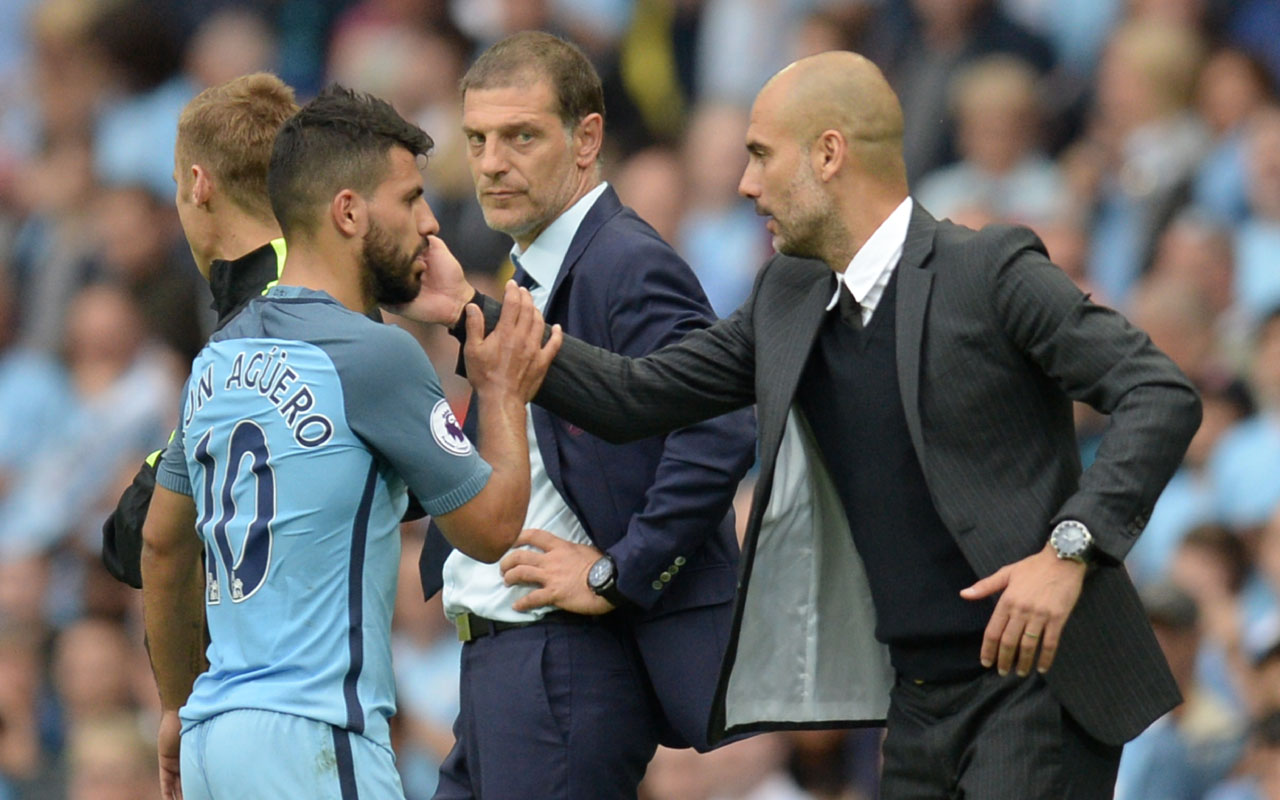 Manchester City's Spanish manager Pep Guardiola (R) greets Manchester City's Argentinian striker Sergio Aguero after he was substituted during the English Premier League football match between Manchester City and West Ham United at the Etihad Stadium in Manchester, north west England, on August 28, 2016. / AFP PHOTO / OLI SCARFF /