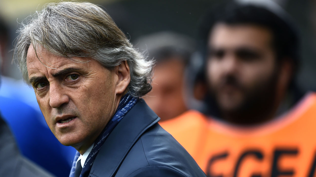 "(FILES) This file photo taken on April 09, 2016 shows Inter Milan's coach Roberto Mancini looking on prior to the italian Serie A football match between Frosinone and Inter at the Matusa Stadium in Frosinone. Inter Milan said on August 8, 2016 its coach Roberto Mancini is leaving, citing a ""mutual agreement"" amid media reports the Serie A club's new Chinese owners decided fresh blood is needed to rejuvenate the team. FILIPPO MONTEFORTE / AFP"