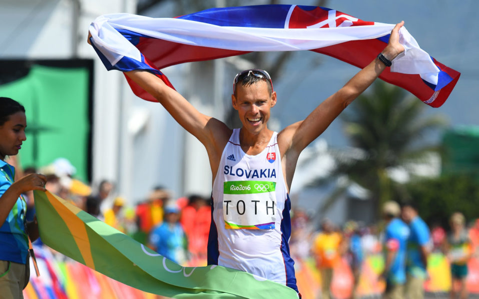 Slovakia's Matej Toth celebrates winning the Men's 50km Race Walk during the athletics event at the Rio 2016 Olympic Games in Pontal in Rio de Janeiro on August 19, 2016.   / AFP PHOTO / Jewel SAMAD