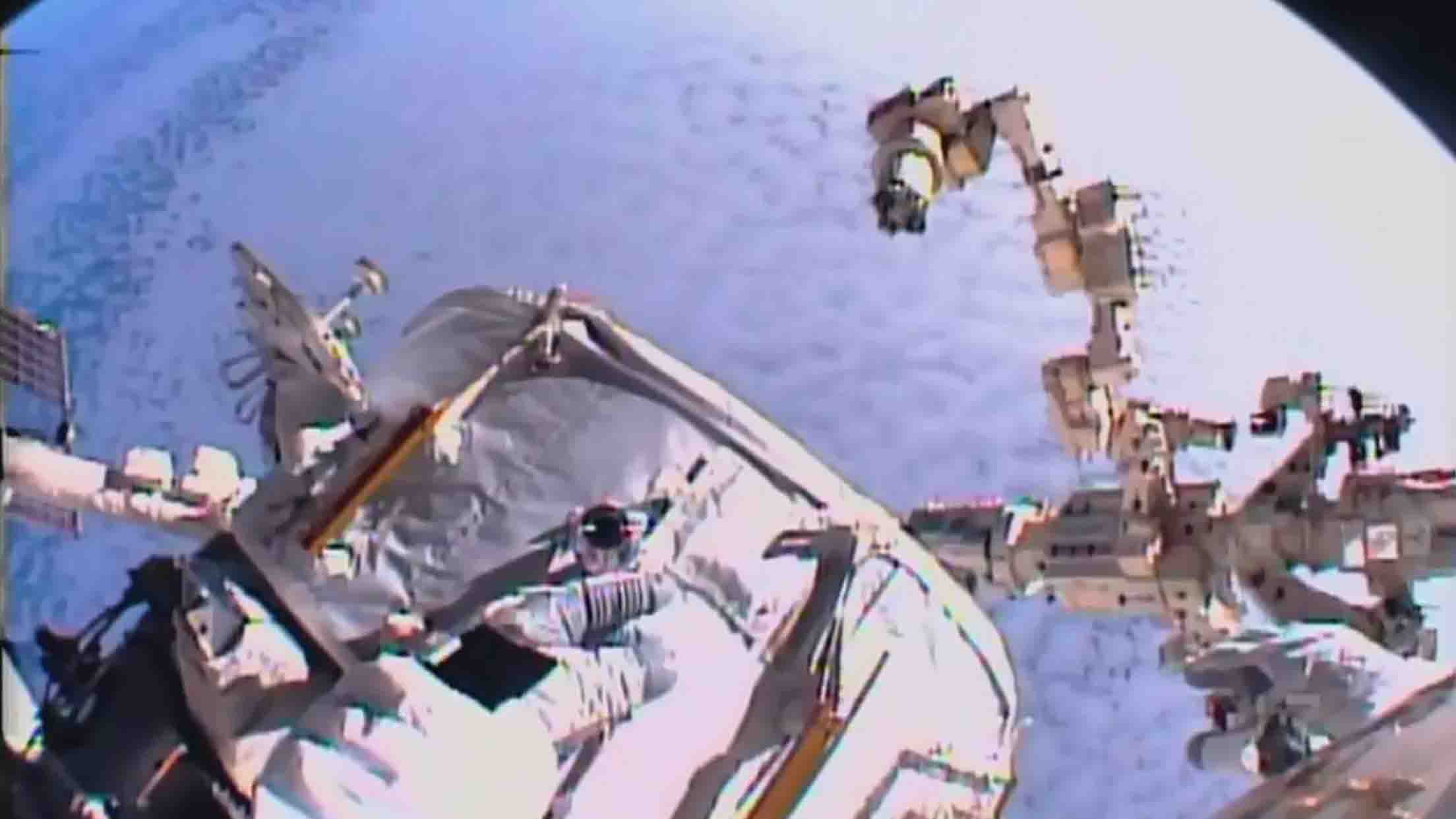 """This NASA TV video grab shows US astronaut Kate Rubins adjusting cables on August 19, 2016 at the International Space Station. With more private spaceship traffic expected at the International Space Station in the coming years, two US astronauts embarked on a spacewalk Friday to install a special parking spot for them. The spacewalk began at 8:04 (1204 GMT) when Americans Jeff Williams and Kate Rubins switched their spacesuits to internal battery power. Shortly afterward, they made their way outside the orbiting laboratory to begin the work of attaching an international docking adaptor, launched aboard a SpaceX Dragon cargo ship last month.  / AFP PHOTO / NASA TV / HO / RESTRICTED TO EDITORIAL USE - MANDATORY CREDIT """"AFP PHOTO / NASA TV"""" - NO MARKETING NO ADVERTISING CAMPAIGNS - DISTRIBUTED AS A SERVICE TO CLIENTS"""