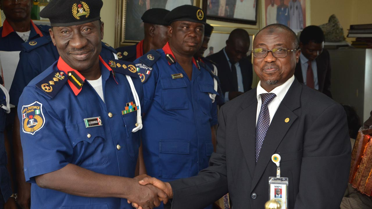 Group Managing Director of the Nigerian National Petroleum Corporation (NNPC) Dr. Maikanti Baru (right) extending hand of partnership to the Commandant General of Nigerian Security Civil Defense Corps,Abdullahi Gani Muhammadu at the corps headquarters in Abuja.