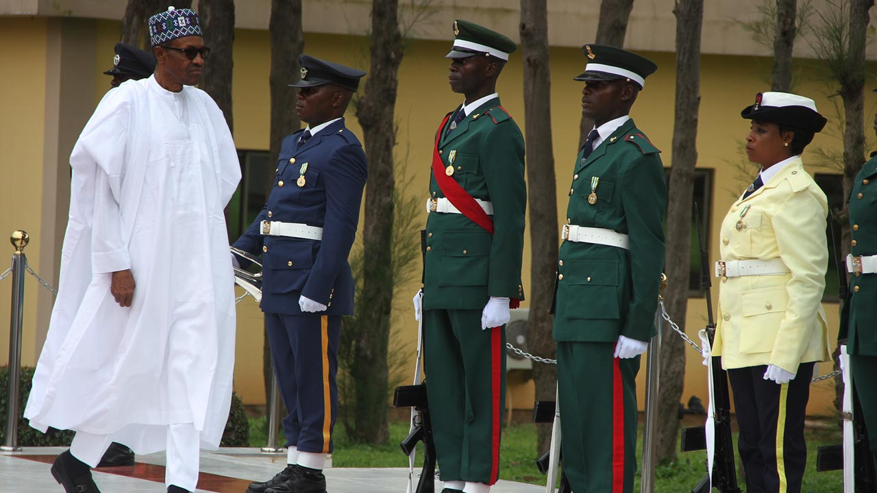 President Muhammadu Buhari left Inspecting a guard of Honour on arrival at the 24th graduation of National war college Abuja on Friday