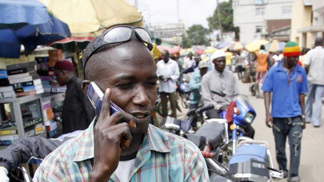 Nigerian making a call, PHOTO: AFP