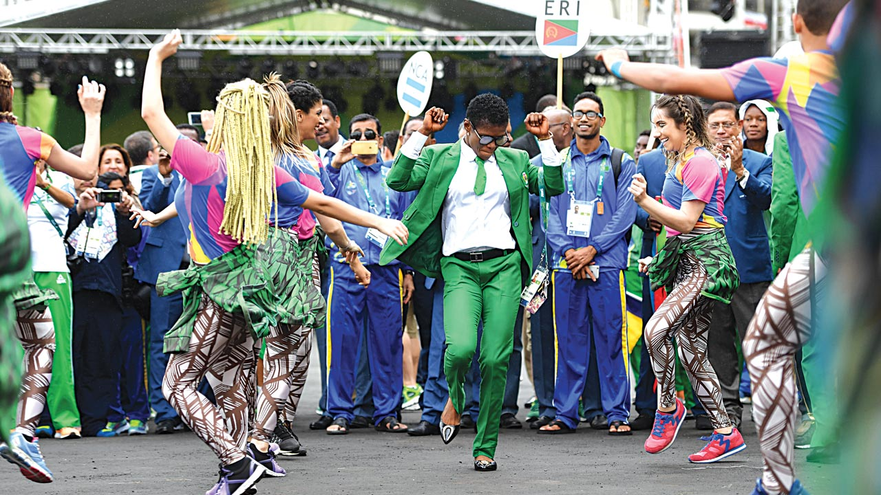 Nigerian athletes join dancers performing during a welcoming ceremony for Team Nigeria's Olympic team at the Athletes' Village. The Rio 2016 Olympic Games officially opened PHOTO: AFP