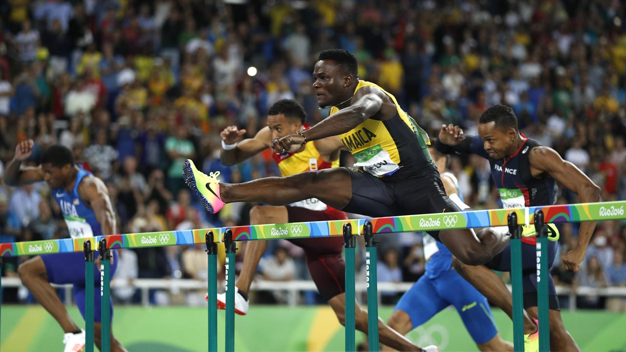 Jamaica's Omar McLeod competes in the Men's 110m Hurdles Final during the athletics event at the Rio 2016 Olympic Games at the Olympic Stadium in Rio de Janeiro on August 16, 2016.  Adrian DENNIS / AFP