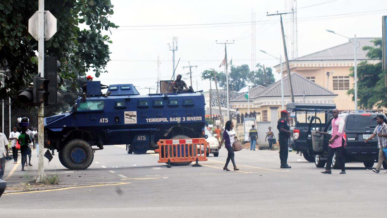Armoured personnel carriers from the anti-terrorism squad from the police Base 3 in Rivers barricading the access to the Sharks Stadium, venue of the PDP national convention in Port Harcourt on Wednesday. PHOTO: NAN