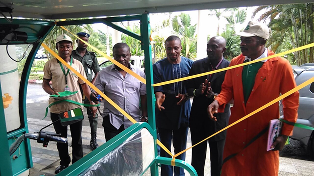L-R: Hon. Commissioner of Environment, Hon. Iniobong Ene Essien, CEO Arthur Energy Technology (AET) Ltd, Engr. Arthur Okeyika, Director public affairs AET Ltd, comrade Princewill Okorie at the ribbon cutting ceremony of Nigeria's first solar powered Tricycle. 1st Akwa Ibom climate change and energy summit