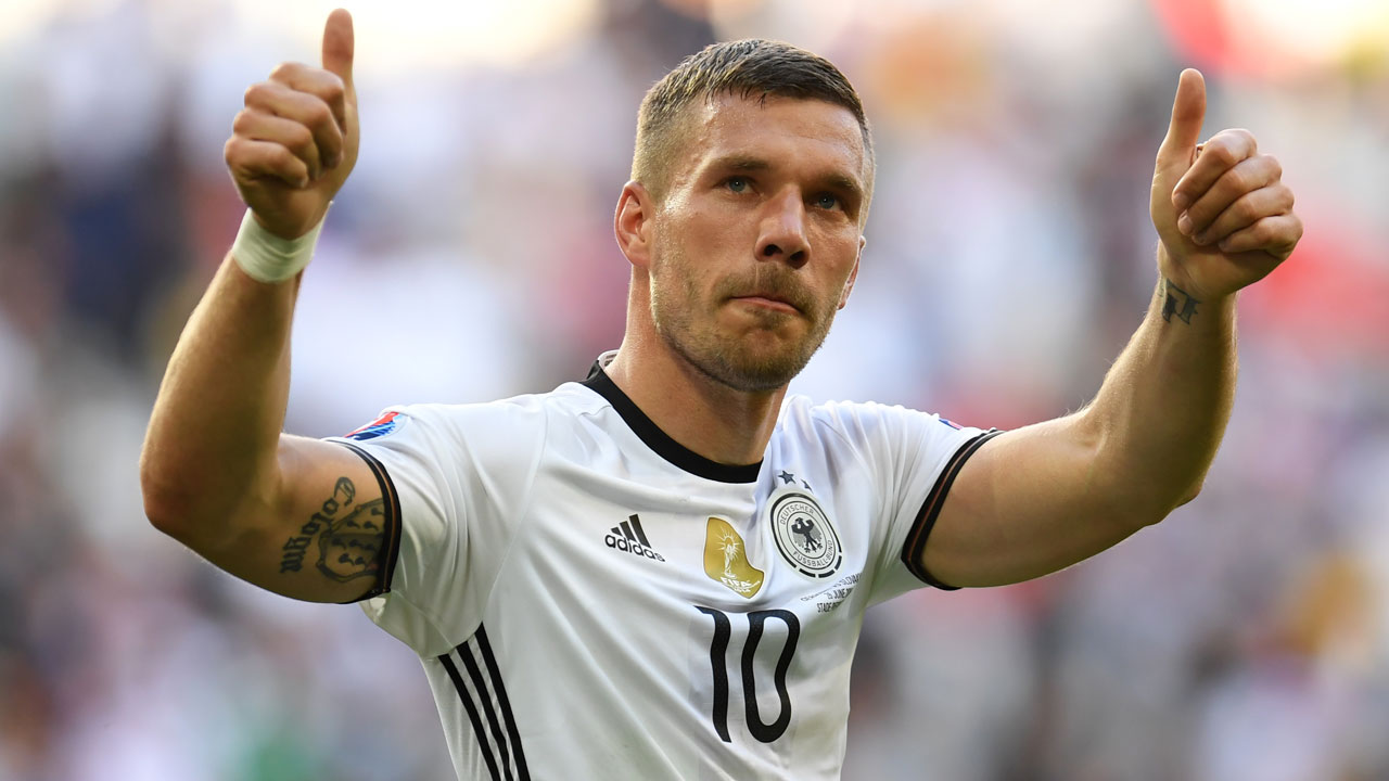 (FILES) This file photo taken on June 26, 2016 shows Germany's forward Lukas Podolski celebrating at the end of the Euro 2016 round of 16 football match between Germany and Slovakia at the Pierre-Mauroy stadium in Villeneuve-d'Ascq near Lille on June 26, 2016. The 31-year old forward, who became World champion with his team in 2014, announced on August 15, 2016 that he will retire from the German national football team. PATRIK STOLLARZ / AFP