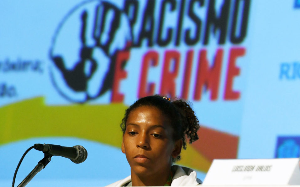 Rio 2016 Olympic Games women's -57kg judo gold medal winner Rafaela Silva is seen during a press conference about racism in Rio de Janeiro on August 10, 2016 / AFP PHOTO / VANDERLEI ALMEIDA