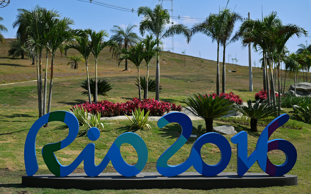 A sign Rio 2016 at the X-Park whitewater rafting venue in Deodoro, Rio de Janeiro, on August 4, 2016, ahead of the Rio 2016 Olympic Games. / AFP PHOTO / CARL DE SOUZA