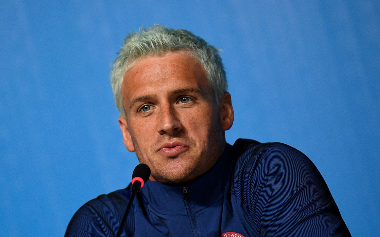 (FILES) This file photo taken on August 03, 2016 shows US swimmer Ryan Lochte holding a press conference in Rio de Janeiro, two days ahead of the opening ceremony of the Rio 2016 Olympic Games. Brazilian police have prevented two more U.S. swimmers from leaving the country after the Rio de Janeiro Olympics over the investigation of a robbery complaint by teammate Ryan Lochte. According to a report on O Globo Web site, swimmers Gunnar Bentz and Jack Conger were arrested and removed from their plane so Brazilian federal police could interview them Wednesday night. The U.S. Olympic Committee later confirmed their detention. / AFP PHOTO / MARTIN BUREAU