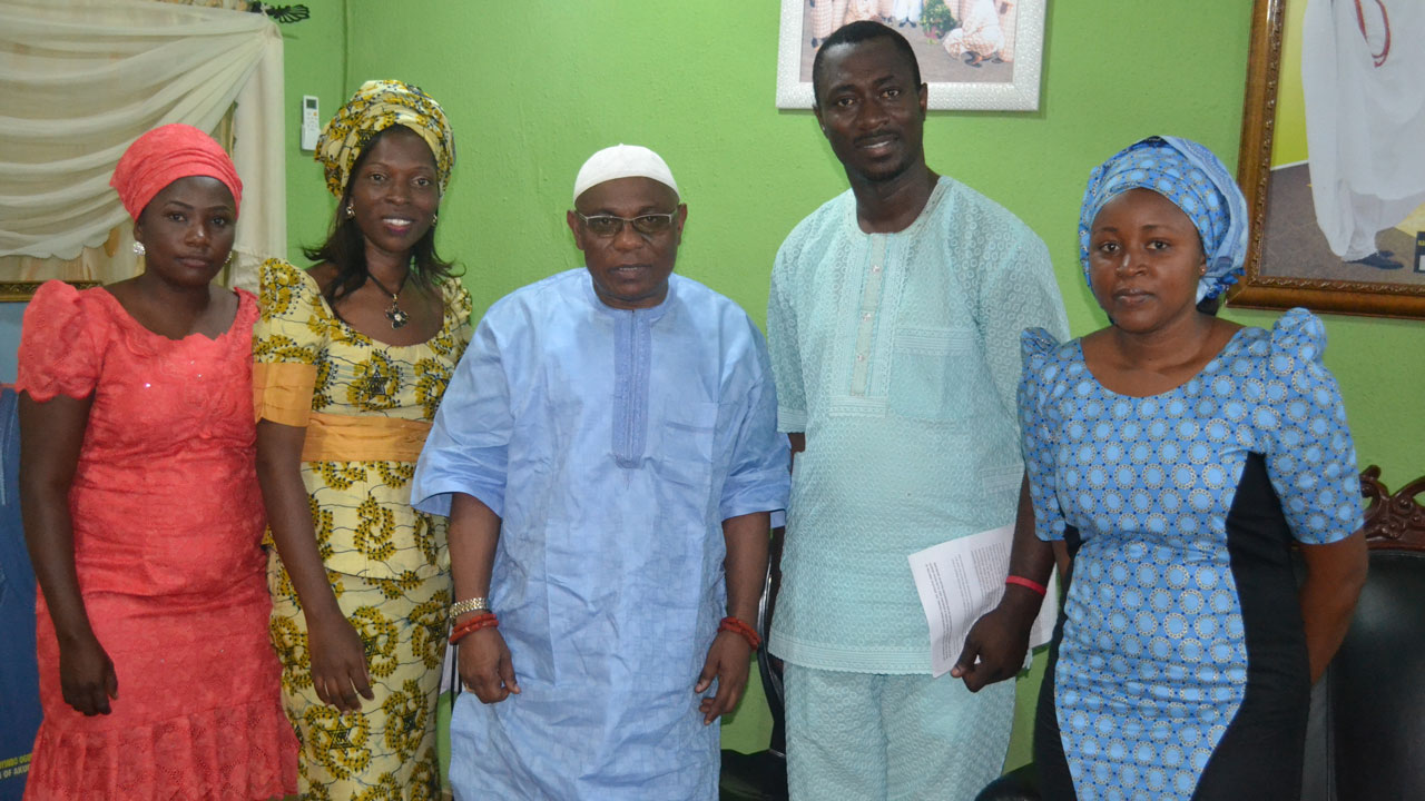 The Deji of Akure, Oba Aladelusi Aladetoyinbo (m), flanked by members of the Kids and Teens Resource Centre (K&TRC), during his conferment as Life Patron of the group.