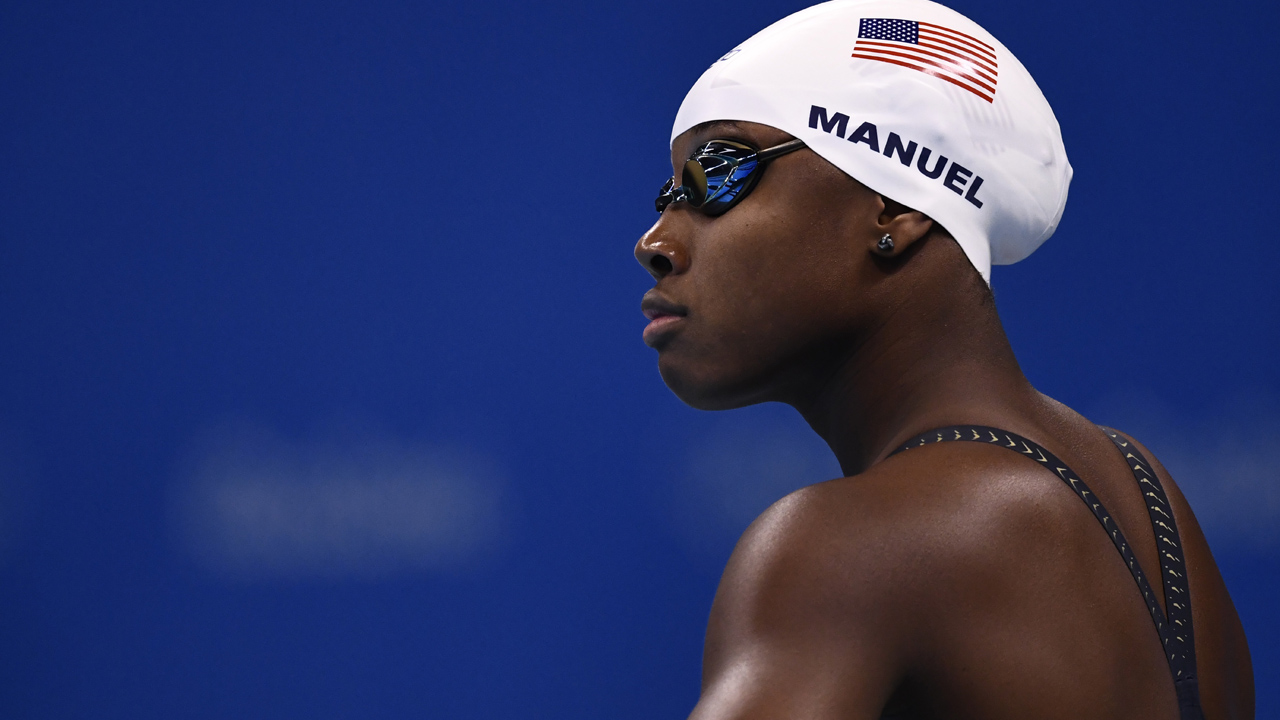 Simone Manuel of USA gets ready for the Women's 50m Freestyle heats during the swimming event at the Rio 2016 Olympic Games at the Olympic Aquatics Stadium in Rio de Janeiro on August 12, 2016. / AFP PHOTO / CHRISTOPHE SIMON