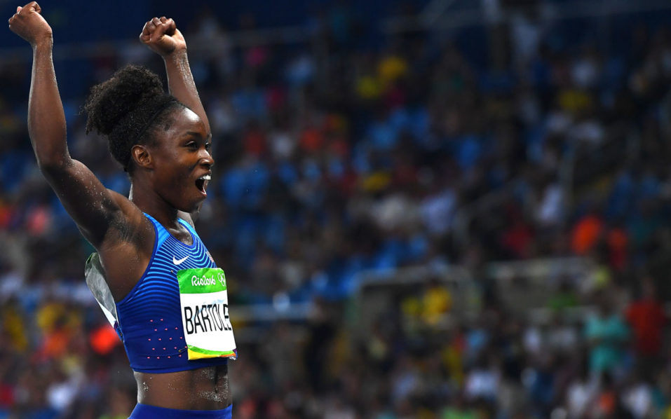 USA's Tianna Bartoletta celebrates winning the gold medal in the Women's Long Jump Final during the athletics event at the Rio 2016 Olympic Games at the Olympic Stadium in Rio de Janeiro on August 17, 2016.   / AFP PHOTO / FRANCK FIFE