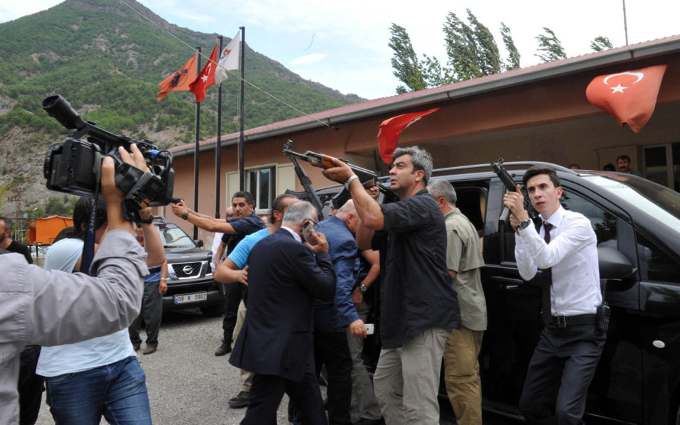This handout picture taken and released on August 25, 2016 by the Republican People's Party (CHP) Press Service shows Turkish Police officers and security members protecting CHP's leader Kemal Kilicdaroglu's (C) after his convoy was attacked by Kurdish militants. Three Turkish troops were wounded on August 25, 2016 when Kurdish militants opened fire on the convoy of Republican People's Party (CHP) leader Kemal Kilicdaroglu but the opposition chief was unharmed, Turkish Interior Minister Efkan Ala said. He also said the attack was carried out by the Kurdistan Workers' Party (PKK) and an operation had been begun against them in the area.  / AFP PHOTO / Republican People's Party (CHP) Press Service / STRINGER /