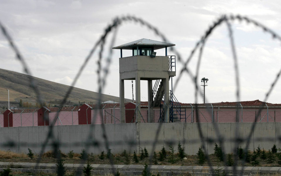 "(FILES) This file photo taken on November 02, 2012 shows a watchtower of the Sincan prison, outside Ankara. Turkey will grant early release to some 38,000 prisoners who committed crimes before July 1, Justice Minister Bekir Bozdag said on August 17, 2016, amid reports of prison overcrowding after the failed coup. Bozdag said in a series of messages on Twitter that the move was ""not an amnesty"". It will not apply to convicts guilty of murder, terrorism or state security as well as the thousands jailed after the putsch which took place on July 15.   / AFP PHOTO / ADEM ALTAN"