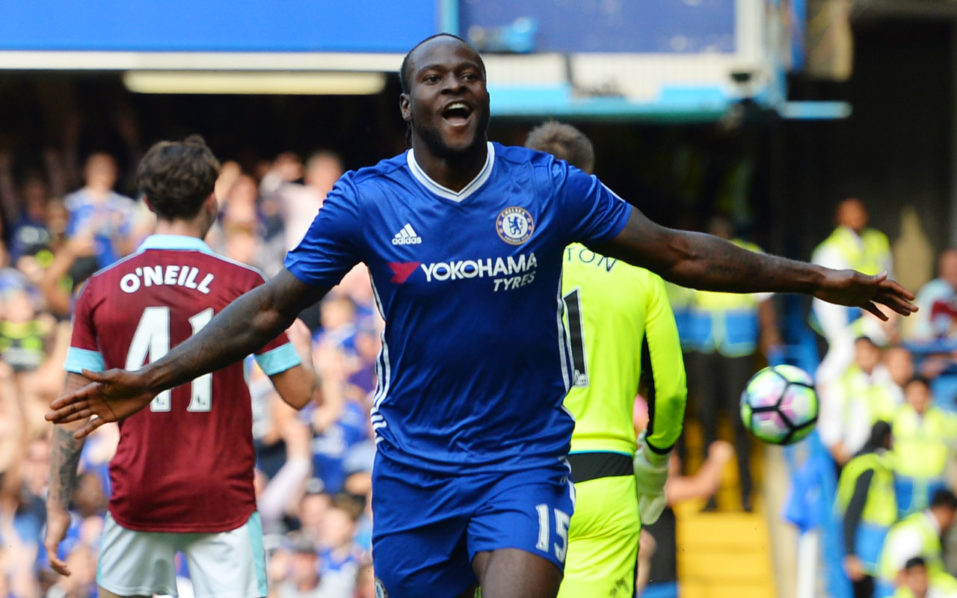 Chelsea's Nigerian midfielder Victor Moses celebrates after scoring during the English Premier League football match between Chelsea and Burnley at Stamford Bridge in London on August 27, 2016. / AFP PHOTO / GLYN KIRK / RESTRICTED TO EDITORIAL USE. No use with unauthorized audio, video, data, fixture lists, club/league logos or 'live' services. Online in-match use limited to 75 images, no video emulation. No use in betting, games or single club/league/player publications.  /