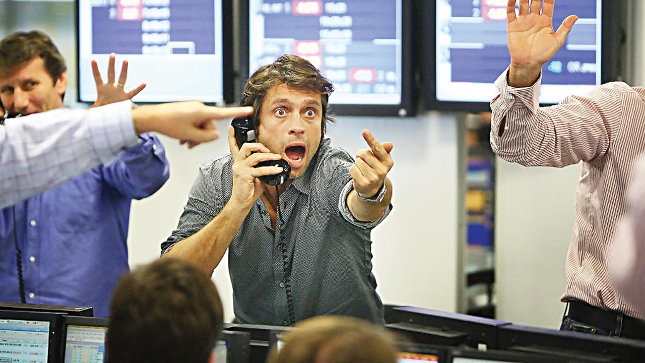 Brokers on the floor of the New York Stock Exchange .PHOTO: Reuters