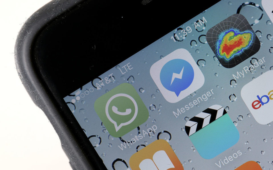 This file photo taken on April 5, 2016 shows the WhatsApp application  displayed on a iPhone in San Anselmo, California.  Mobile messaging service WhatsApp on August 25, 2016 announced it would begin sharing subscriber data with parent Facebook, giving advertisers better access to information on WhatsApp's one billion-strong user base.The company said the change would allow Facebook to target advertising at WhatsApp users who are also on the social media platform, and help WhatsApp fight spam on its service.  / AFP PHOTO / GETTY IMAGES NORTH AMERICA / JUSTIN SULLIVAN