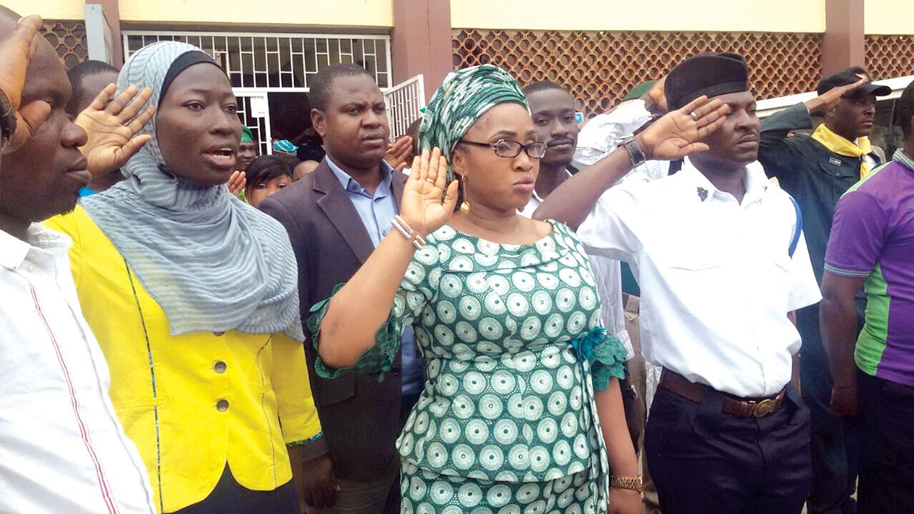Vice Chairman, Lagos chapter of the National Youth Council, Rashidat Yusuf (left); Pharm. (Mrs.) Uzamat Akinbile-Yussuf and chairman, Comrade Olayinka Oresile at the parade to mark the International Youth Day.