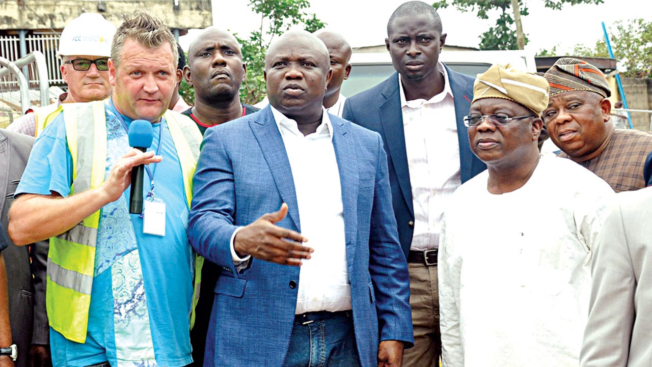 Lagos State Governor Akinwunmi Ambode (middle), Director, Project, Fountain Construction Company (FCC), Thomas Cunningham (left) Commissioner for Works & Infrastructure, Ganiyu Johnson (right) and Commissioner for the Environment, Dr. Babatunde Adejare (right behind) during the governor's inspection of the road projects at Oworosonki, Lagos…at the weekend.