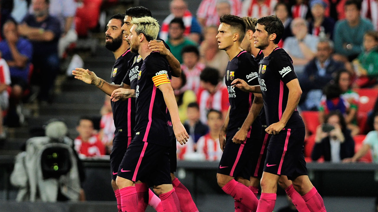 Barcelona's players celebrate after scoring the opener during the Spanish league football match Athletic Club Bilbao vs FC Barcelona at the San Mames stadium in Bilbao on August 28, 2016. ANDER GILLENEA / AFP