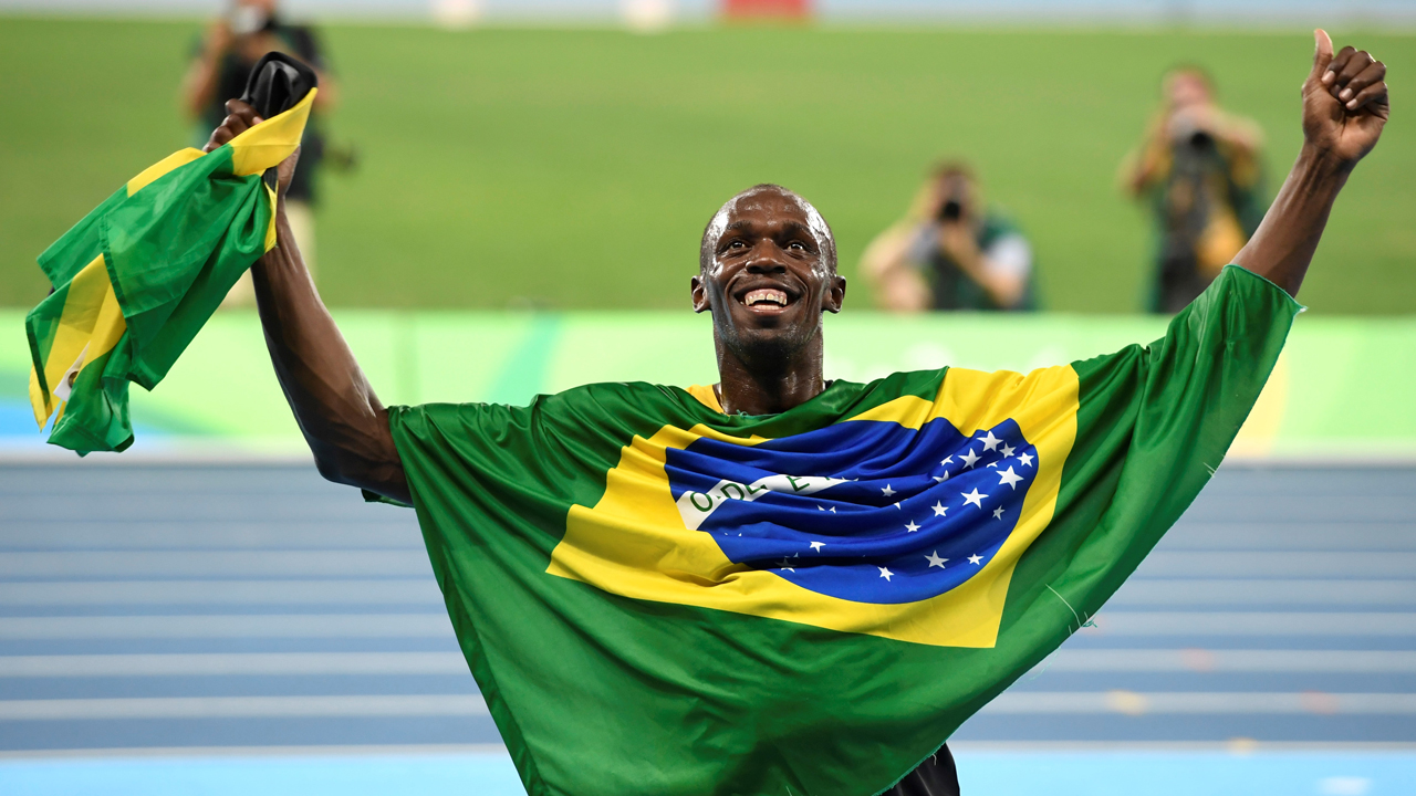 Jamaica's Usain Bolt celebrates his team's victory at the end of the Men's 4x100m Relay Final during the athletics event at the Rio 2016 Olympic Games at the Olympic Stadium in Rio de Janeiro on August 19, 2016. Eric FEFERBERG / AFP