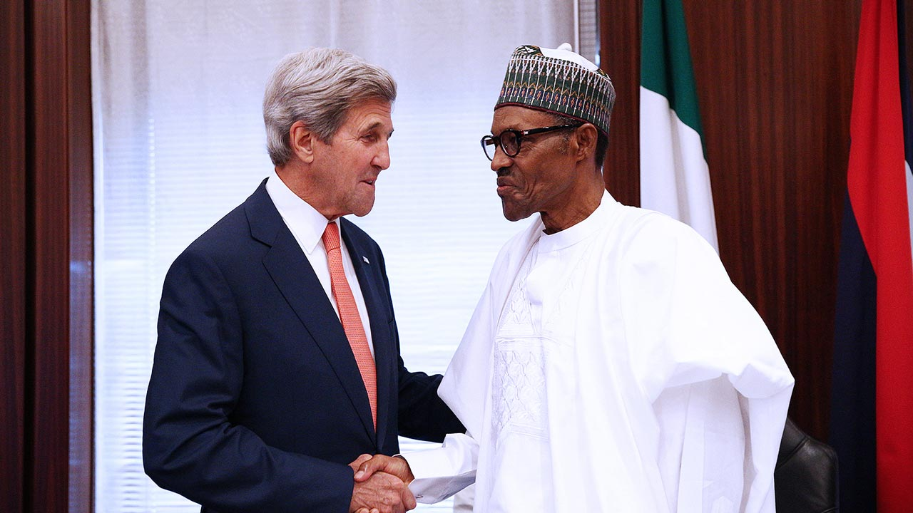 Nigerian President Muhammadu Buhari (R) welcomes US Secretary of State John Kerry upon his arrival at the Presidential villa in the Nigerian capital of Abuja, on August 23, 2016, as part of Kerry's three-nation tour focussed on counterterrorism. Kerry on August 23, 2016 congratulated Nigeria on its recent military successes against Boko Haram while warning against the use of excessive force to fight extremists. PHOTO: PHILIP OJISUA / AFP