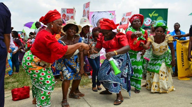 Nigerian women dancing at a political rally.