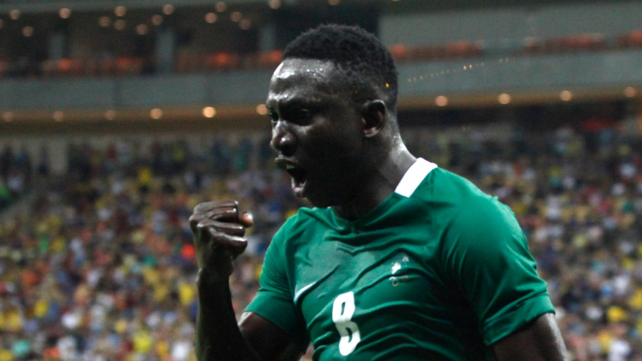 Nigeria's player Oghenekaro Etebo (8) celebrates the team's third goal against Japan during the Rio 2016 Olympic Games men's First Round Group B football match Nigeria vs Japan, at the Amazonia Arena in Manaus on August 4, 2016. RAPHAEL ALVES / AFP