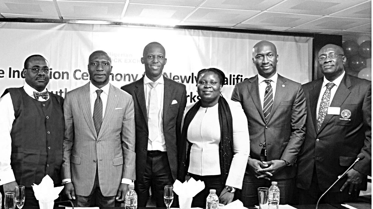 Council Member, Nigerian Stock Exchange (NSE), Dunama Stanley Balami (left); Chief Executive Officer, Oscar N. Onyema, Executive Director, Market Operations and Technology, Ade Bajomo, Head, Council Secretariat/Council Secretary, Adeola Mojisola; Head, Corporate Services Division, Bola Adeeko and Chairman, Association of Stockbroking Houses of Nigeria (ASHON), Emeka Madubuike at the induction ceremony for recently qualified dealing clerks at the Nigerian Stock Exchange in Lagos.