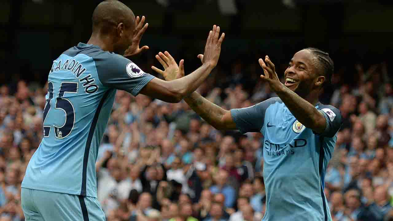 Manchester City's English midfielder Raheem Sterling (R) celebrates with Manchester City's Brazilian midfielder Fernandinho after scoring during the English Premier League football match between Manchester City and West Ham United at the Etihad Stadium in Manchester, north west England, on August 28, 2016. / AFP PHOTO / OLI SCARFF / RESTRICTED TO EDITORIAL USE. No use with unauthorized audio, video, data, fixture lists, club/league logos or 'live' services. Online in-match use limited to 75 images, no video emulation. No use in betting, games or single club/league/player publications. /